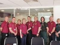 A group of volunteers celebrating at Yorkshire Ambulance Service HQ