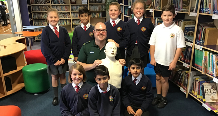 John Spikings, Community Defibrillation Trainer with pupils at Crossley Fields Junior and Infant School