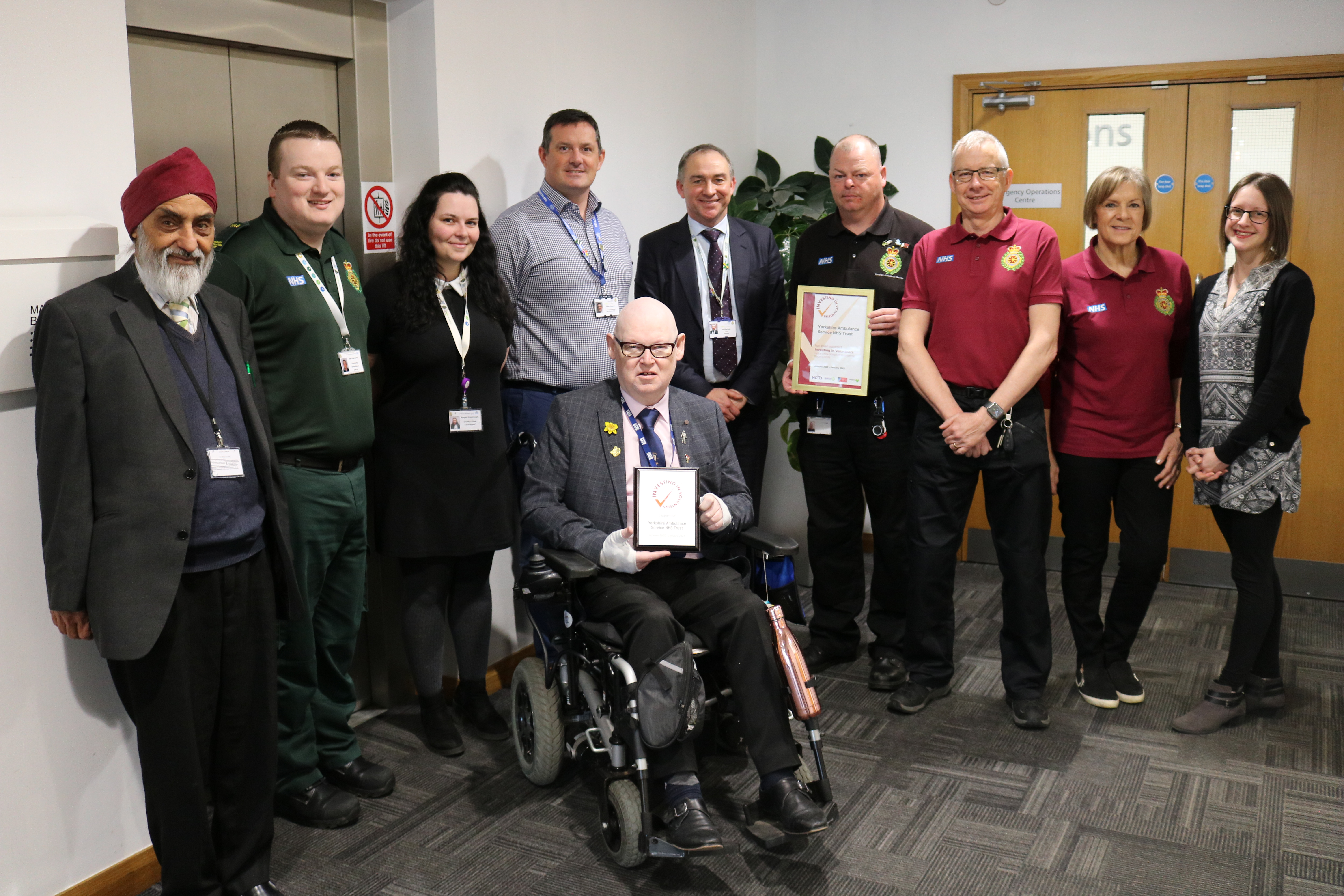 Staff and volunteers celebrate Investing in Volunteers Accreditation